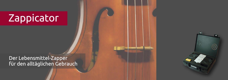 Man sieht den Ausschnitt eines Cellos als Symbol für Frequenztherapie