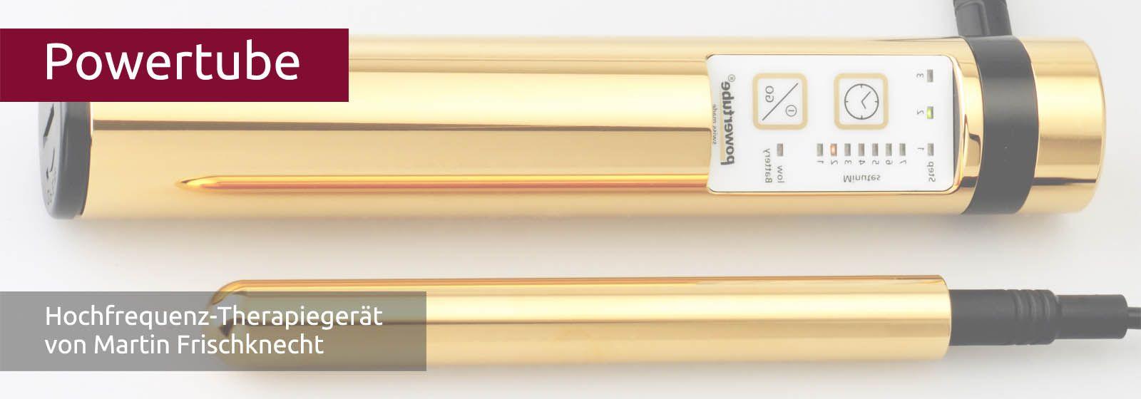 Man sieht das goldene, stabförmige Hochfrequenz-Gerät mit Zusatzelektrode